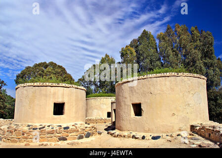 Reconstructed structures  in the archaeological site of Choirokoitia (UNESCO World Heritage Site), a neolithic settlement, - Stock Photo