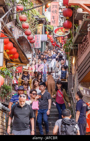 Tourists walk down famed steps in Jiufen old street - Stock Photo