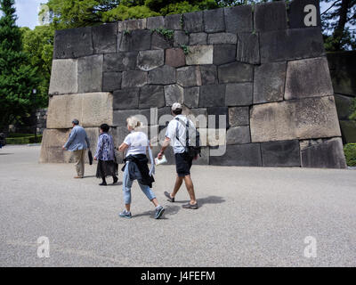Tourists visiting the Eatsern Gardens of the Imperial Palace. Tokyo, Japan. - Stock Photo