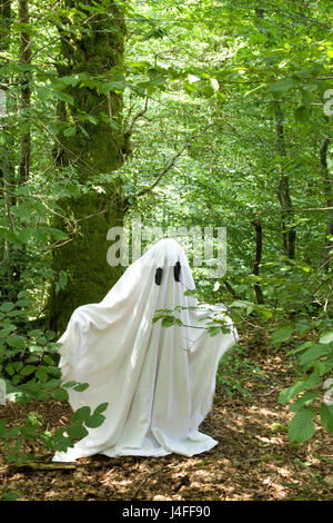 white ghost in forest - Stock Photo