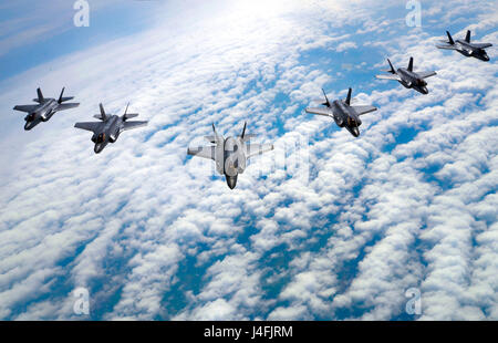 F-35 Lightning II's fly in formation during a training flight - Stock Photo