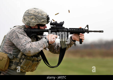 U.S. Air Force Senior Airman, a security forces specialist fires an M4 carbine rifle during target practice - Stock Photo