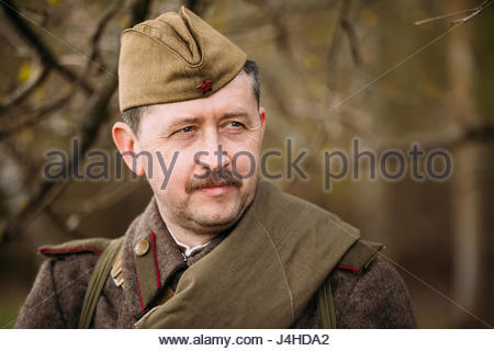 Pribor, Belarus - April 23, 2016: Close up portrait of Re-enactor Dressed As Russian Soviet Infantry Soldier Of - Stock Photo