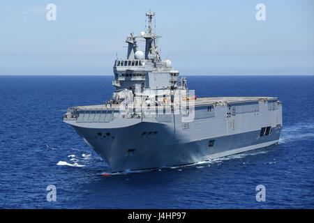 The French Navy Mistral-class amphibious assault ship FS Dixmude steams underway August 6, 2016 in the Gulf of Cadiz, - Stock Photo