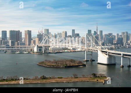 Tokyo Bay with a view of the Tokyo skyline and Rainbow Bridge in tokyo, Japan. - Stock Photo
