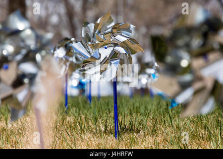 Pinwheels for Prevention, symbols for Prevention Against Child Abuse month, central Colorado, USA - Stock Photo
