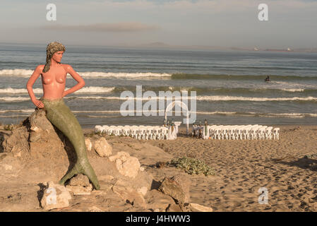 LANGEBAAN, SOUTH AFRICA - APRIL 1, 2017: Preparations for a wedding under the watchful eyes of a mermaid on the - Stock Photo