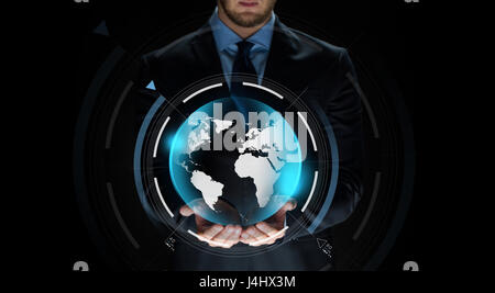 close up of businessman with earth projection - Stock Photo