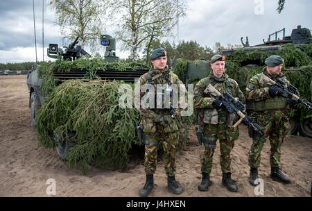 British soldiers in full battle uniform stand for review during a NATO training exercise at the Pabrade Training - Stock Photo