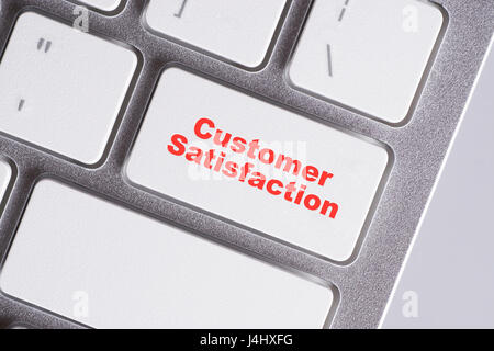 'Customer Satisfaction' red words on white keyboard - online, education and business concept - Stock Photo