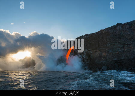 hot lava from the 61G flow from Kilauea Volcano enters the ocean at the Kamokuna entry in Hawaii Volcanoes National - Stock Photo