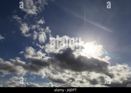A partly obscured sun trys to break through some Stratocumulus clouds - Stock Photo