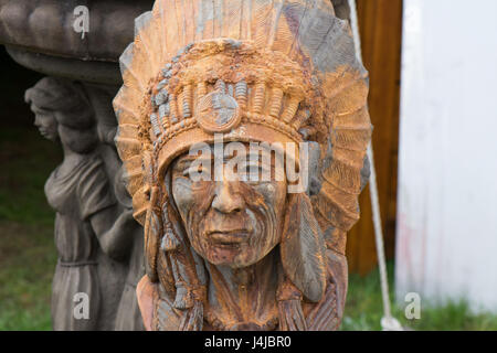 Native american tribal chief sculpture at antique fair. - Stock Photo