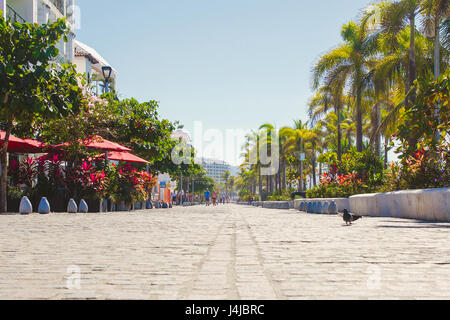 February 21, 2017: Malecon Boardwalk in Puerto Vallarta a famous tourist vacation destination with many shops and - Stock Photo
