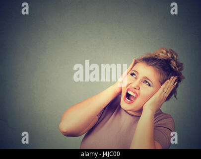 Stressed frustrated woman covering her ears with hands. - Stock Photo
