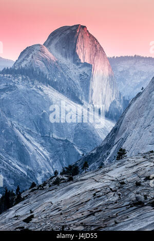 Sunset over the Northern side of Half Dome in Yosemite National Park from Olmsted Point. - Stock Photo