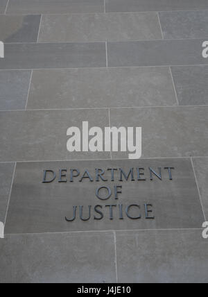 U.S. Department of Justice nameplate on outside of headquarters building, Washington, D.C., USA - Stock Photo
