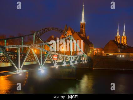 old town of Wroclaw - bridge to island Tumski illuminated at night, Poland - Stock Photo