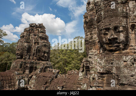 Enigmatic smiling carved faces, Prasat Bayon, Angkor, Siem Reap, Cambodia - Stock Photo