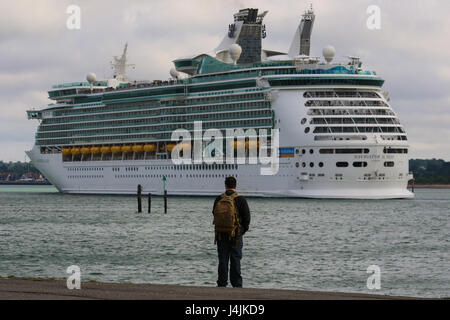 A person watches on at Royal Caribbean's MS Navigator of the Seas departs Southampton Port. - Stock Photo