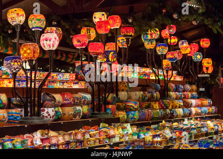 STUTTGART, GERMANY - DECEMBER 3, 2016: Colorful glass candle holders in a kiosk at Christmas market (Weihnachtsmarkt) - Stock Photo