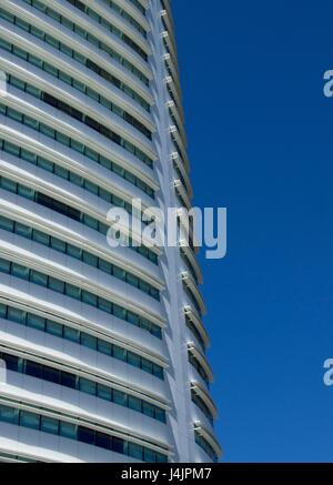 Modern building against blue sky. - Stock Photo