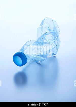 Crushed plastic bottle, studio shot. - Stock Photo