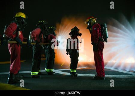 161104-N-GI544-007 PEARL HARBOR (Nov. 4, 2016) Petty Officer 1st Class Jessica Grover, high-risk firefighting instructor - Stock Photo