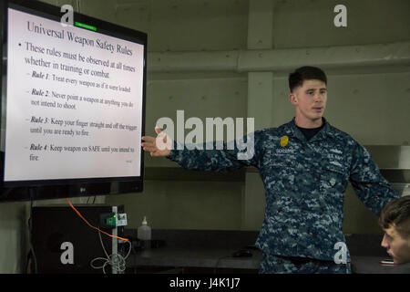 161114-N-TH560-005 SASEBO, Japan (Nov. 14, 2016) Petty Officer 2nd Class William Sickler, from Old Town, Fla., instructs - Stock Photo