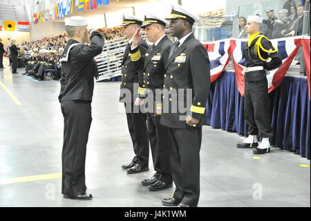 161216-N-CM124-295   GREAT LAKES, Ill. (Dec. 16, 2016) Chief of Naval Personnel Robert P. Burke salutes a recruit - Stock Photo