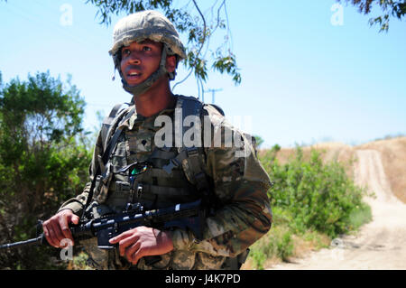Spc. Charles Cherry, a paralegal specialist with the 79th ...