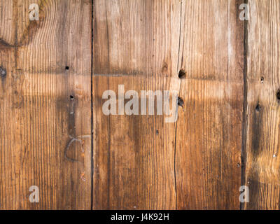 Old wooden brown planks with holes for nails - Stock Photo