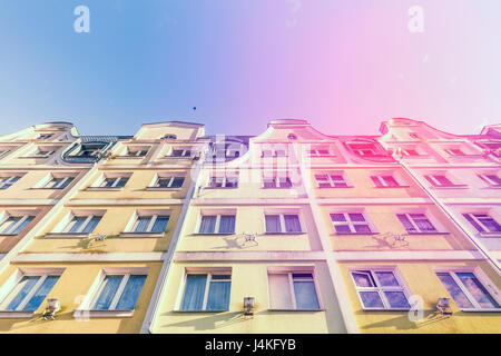 Colorful Renaissance Facades of European Buildings Against Cloudless Sky - Stock Photo