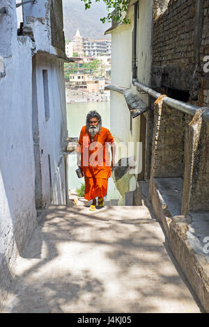 INDIA, LAXMAN JHULA - APRIL 15, 2017: Sadhu coming from the river Ganges after doing puja in Laxman Jhula on the - Stock Photo