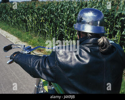 Roadside, Harleyfahrer, back view, detail street, man, motorcyclist, motorcycle driving, means of transportation, - Stock Photo