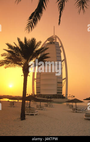 United Arab Emirates, Dubai, five-star hotel Burj Al Arab, palms, beach, sundown front East, the Near East, the - Stock Photo