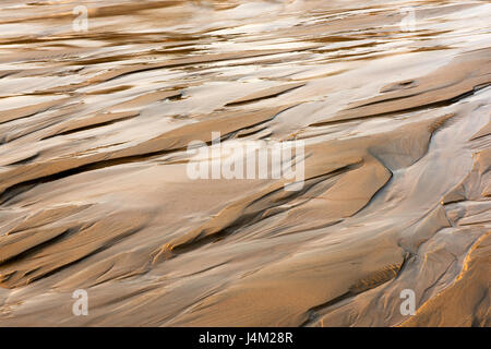 Patterns on the sand from running water. Melting snow in Siberia. Novosibirsk Region, the Ob Sea. - Stock Photo