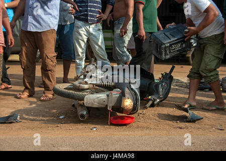 People are gathered at the scene of a motorcycle accident in Chork village, Tboung Khmum province, Cambodia - Stock Photo