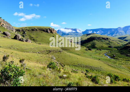 South Africa Drakensberg scenic panoramic landscape view -  Green Giants Castle Wide Panorama with sunny blue sky,clouds,mountains, - Stock Photo