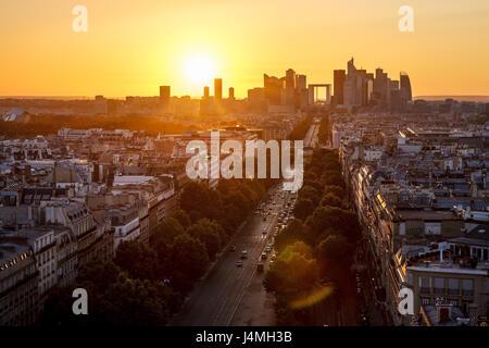 Avenue de la Grande Armee and La Defense neighborhood in Paris at sunset. France