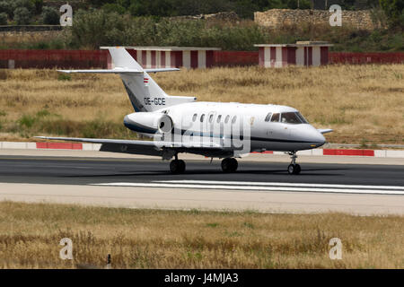 Luqa, Malta May 13, 2017: Goldeck-Flug Raytheon Hawker 800XP [OE-GCE] landing runway 31. - Stock Photo
