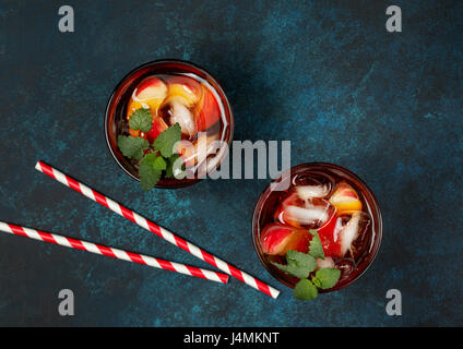 Peach ice tea in glass on  concrete blue background. view from above - Stock Photo