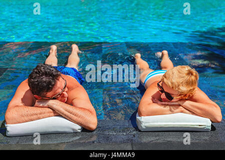Successful retirement recreation, summer vacation concept. Retired mature couple enjoying beautiful sunny day in - Stock Photo