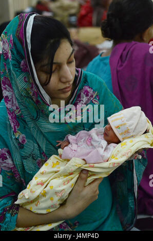 Mother's Day is celebrated in Lahore, Pakistan together with their babies, it is a celebration honoring the mother - Stock Photo