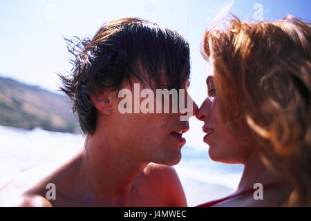 Beach, couple, young, kiss, passionately, at the side, portrait, curled tread, vacation, summer, outside, beach - Stock Photo