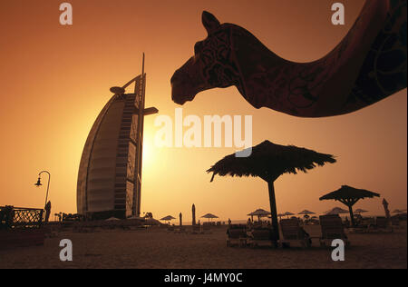 United Arab Emirates, Dubai, five-star hotel Burj Al Arab, palms, beach, camel, sundown front East, the Near East, - Stock Photo