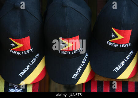 Democratic republic of Timor-Leste, Dili, market, souvenir sales, sign caps, - Stock Photo