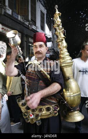 Syria, Damascus, Old Town, Souq, water seller, half portrait, no model release, Souq Al Hamidiyya, bazaar, market, - Stock Photo