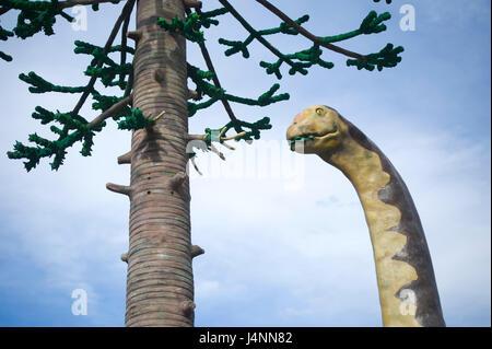 Replica of sauropod camarasaurus eating leafs of araucaria conifer tree near IGEA village, La Rioja, Spain. sauropoda - Stock Photo
