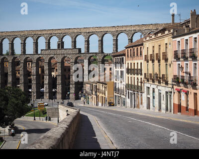 a view Segovia Roman Mirador Aqueduct double arches from the side with row of colourful colorful town houses in - Stock Photo